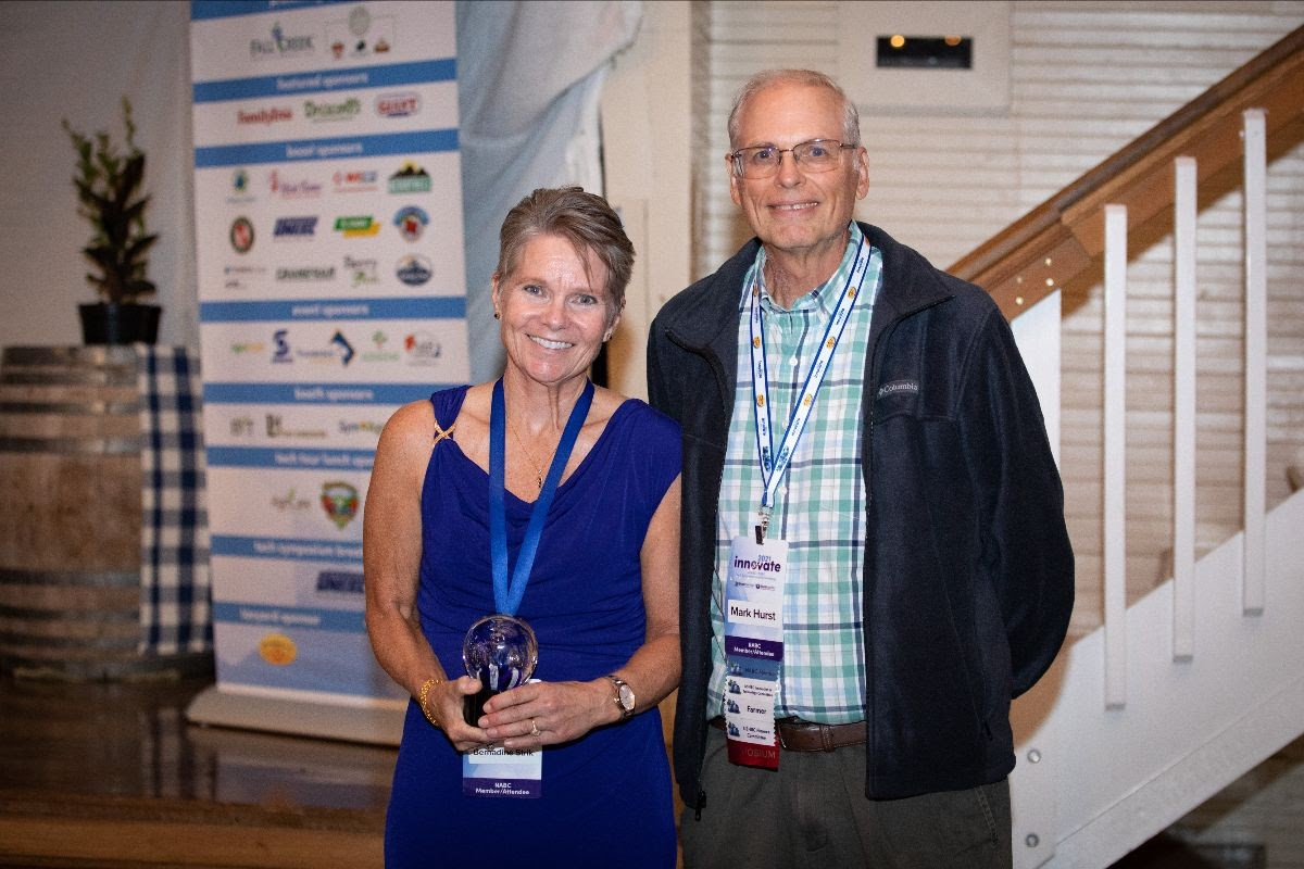 Dr. Bernadine Strik, pictured here with Oregon blueberry grower Mark Hurst, after receiving the Duke Galletta Award.