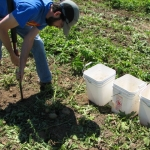 John McQueen taking soil samples
