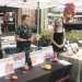 Oregon State University Dry Farming Project student research assistants Kelly Andrus, Asher Whitney and Meaghan Herlihy host a dry-farmed tomato tasting at the Corvallis Farmers Market.