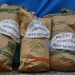 """Bags of patented seeds from Bayer/Monsanto, one of the """"Big Four"""" seed companies. Photo by: John Macdougall/AFP via Getty Images"""