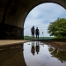 In this May 14, 2018 file photo, a couple walks on a path at Fairmount Park as they proceed under the trestle bridge over the Schuylkill River in Philadelphia. Tending your garden also offers lessons for growing your money. Start by defining what you want to bring to life. Think about the various aspects of your finances — income, expenses, debts — and imagine what you want them to look like in one or five years' time. (Michael Bryant/The Philadelphia Inquirer via AP)