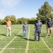 Researchers stand on test plots of various turfgrass cultivars. From left are Clint Mattox, Cole Stover, Wrennie Wang, Alec Kowalewski, Chas Schmid, and Emily Braithwaite. Photo by Sierra Dawn, McClain/Capital Pres.